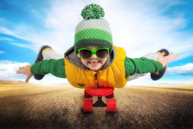 A child riding on a skateboard.Extreme sports. stock photography