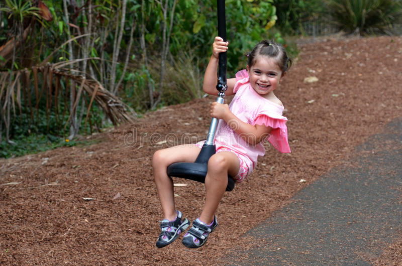 Child rids on Flying Fox stock photography
