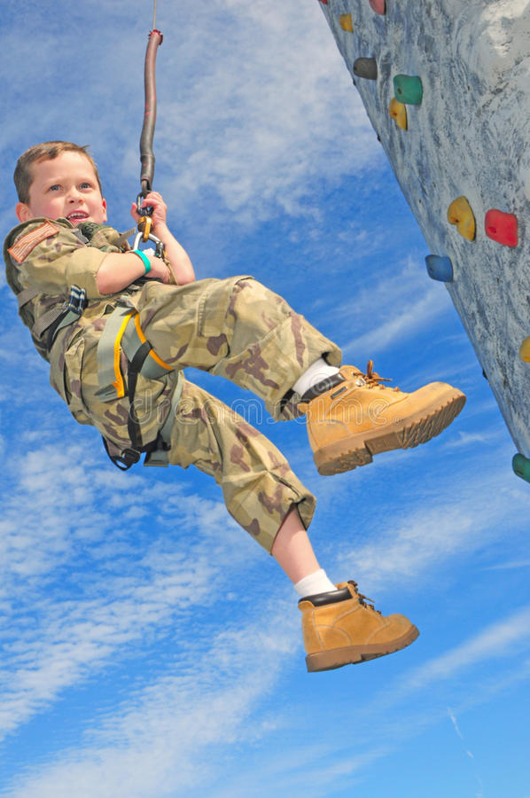 Download Child On Rock Climbing Wall Stock Photo - Image: 12908838