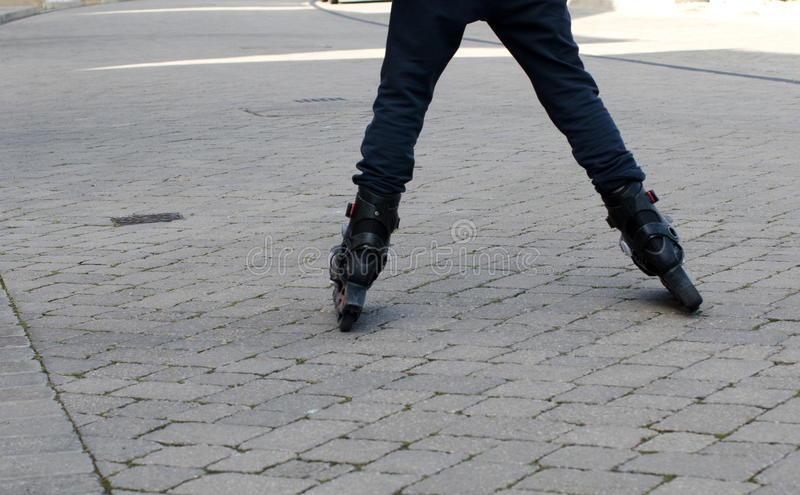 Child Roller Blading. Down a paved street royalty free stock photography