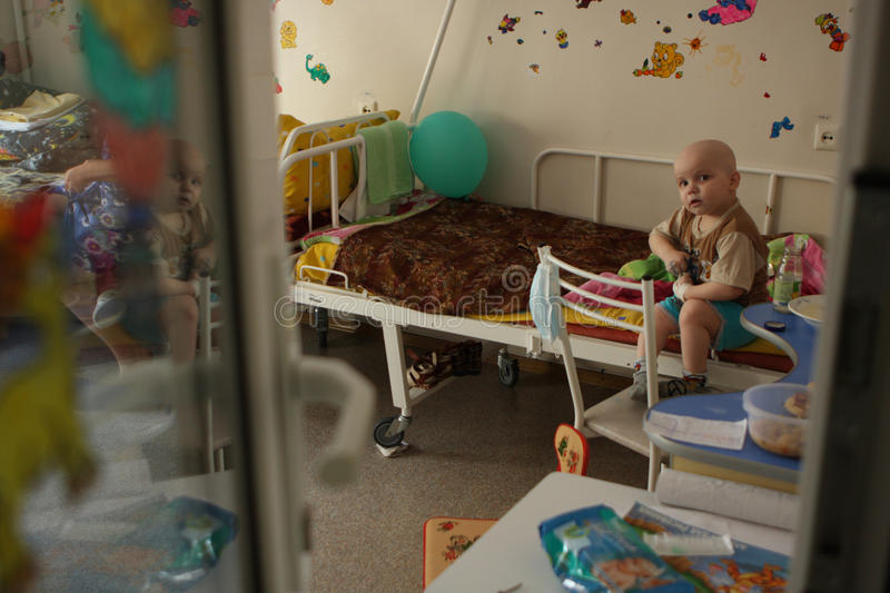 Child in room on oncohematological department stock image