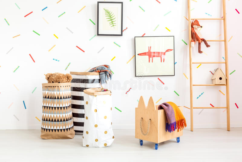Child room with toy bags stock photo