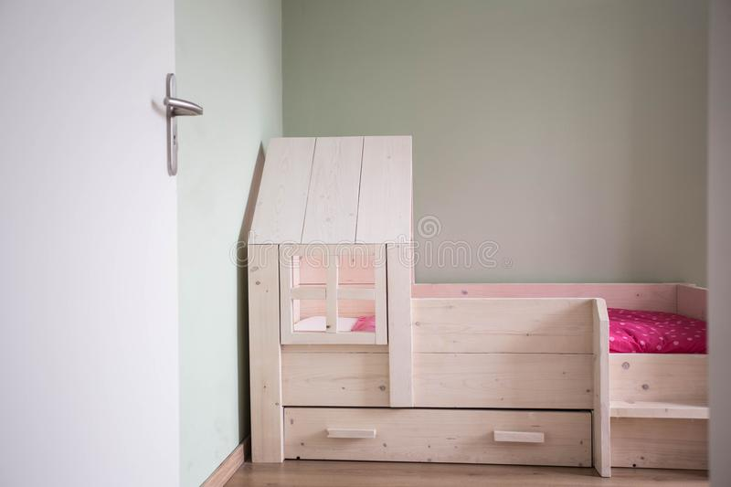 Child room and wood bed with modern design. And green wall royalty free stock photos
