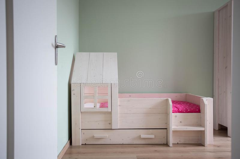 Child room and wood bed modern style. Child room and wood bed with modern design and green wall royalty free stock image