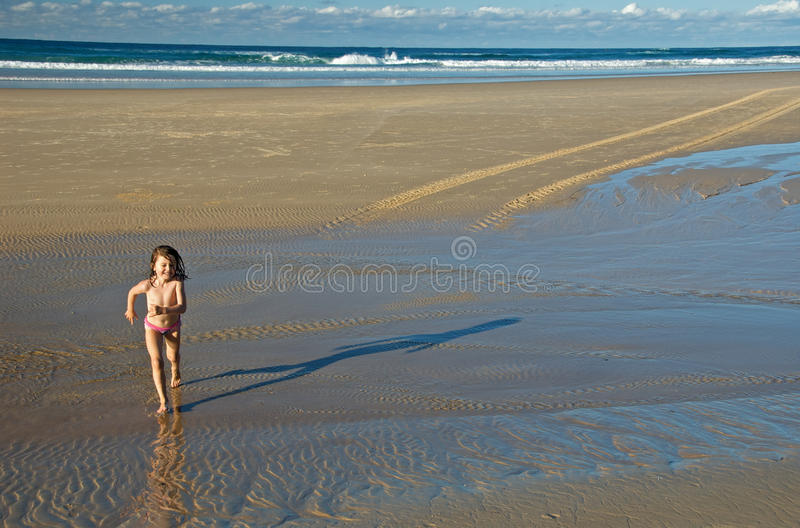 Download Child running on the beach stock photo. Image of freedom - 16838112