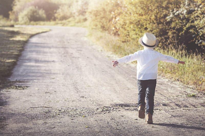 Child running. Down the road stock photo