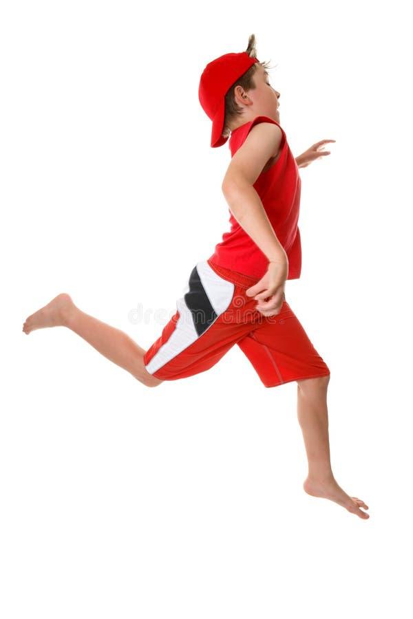 Child running fast stock photo