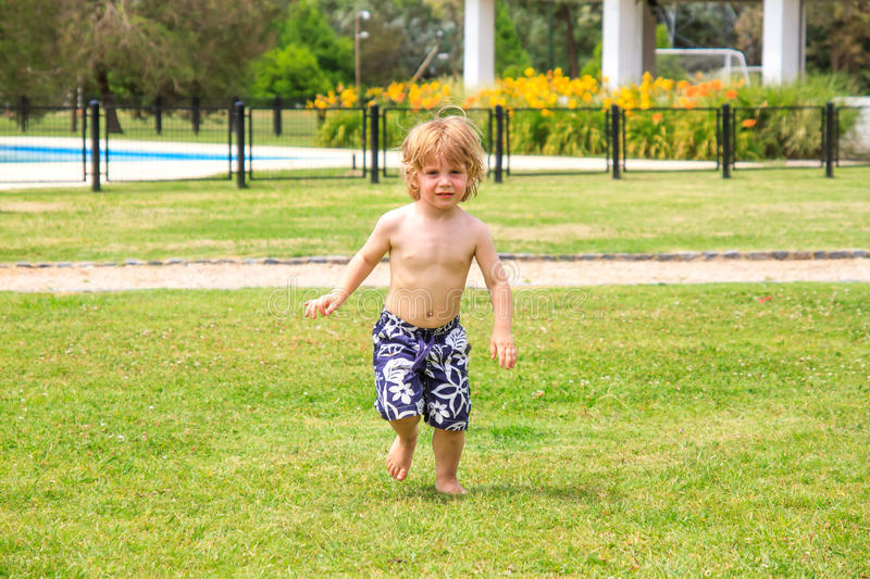 Child running. A child running on the grass stock images
