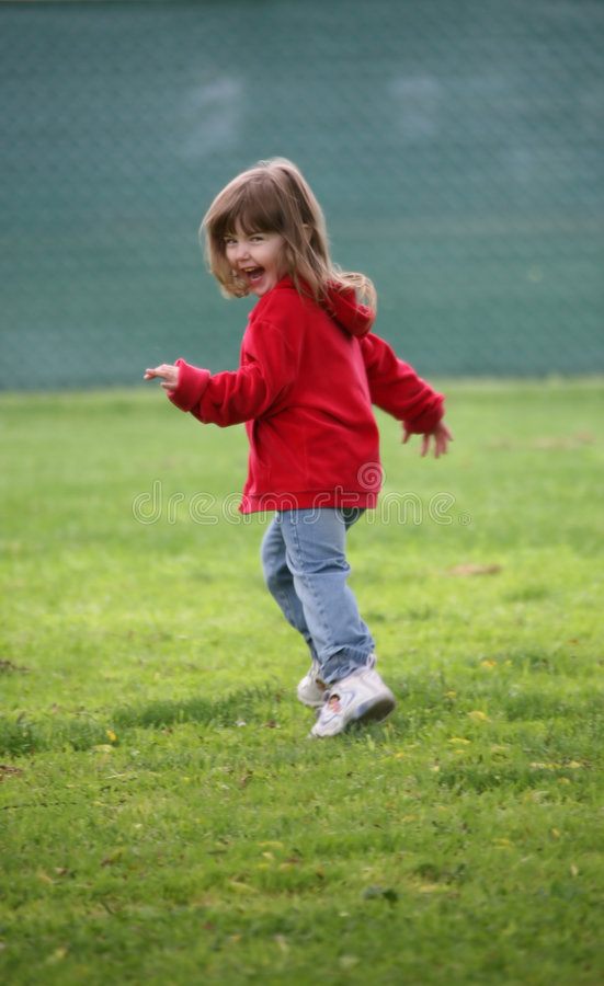 Child Running in the Grass royalty free stock image