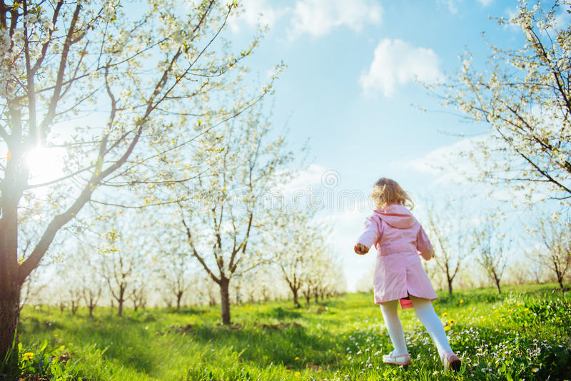 Child running outdoors blossom trees. Art processing and retouch. Ing photos special stock photography