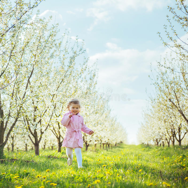 Child running outdoors blossom trees. Art processing and retouch. Ing photos special stock image