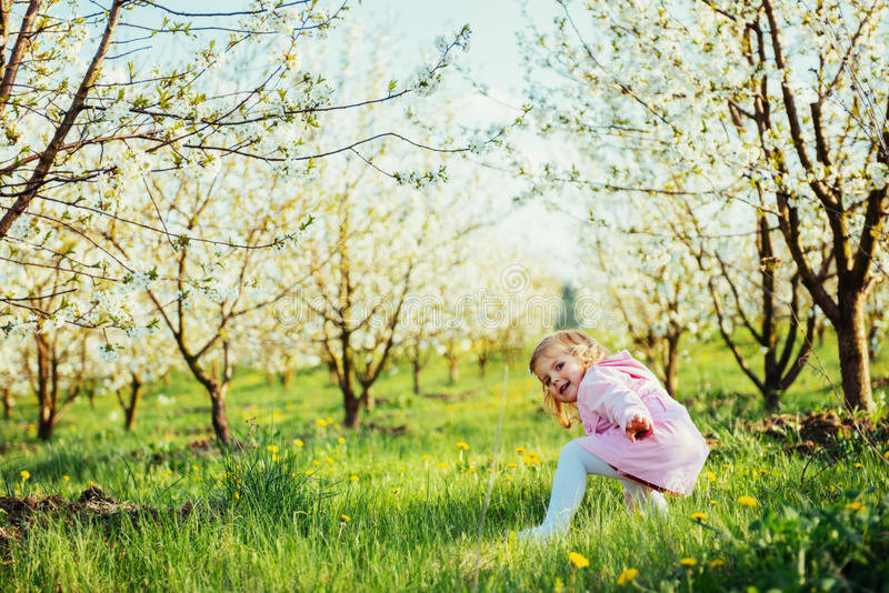 Child running outdoors blossom trees. Art processing and retouch. Ing photos special stock images