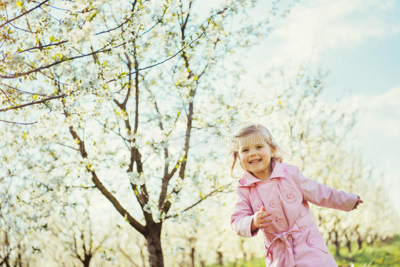 Child running outdoors blossom trees. Art processing and retouch. Ing photos special royalty free stock images