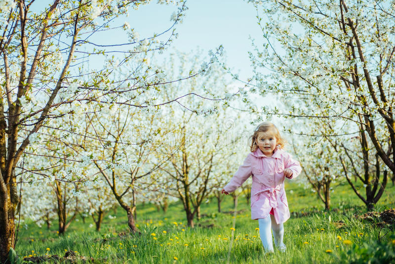 Child running outdoors blossom trees. Art processing and retouch. Ing photos special royalty free stock image