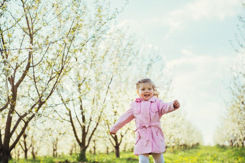 Child running outdoors blossom trees. Art processing and retouch. Ing photos special stock photos