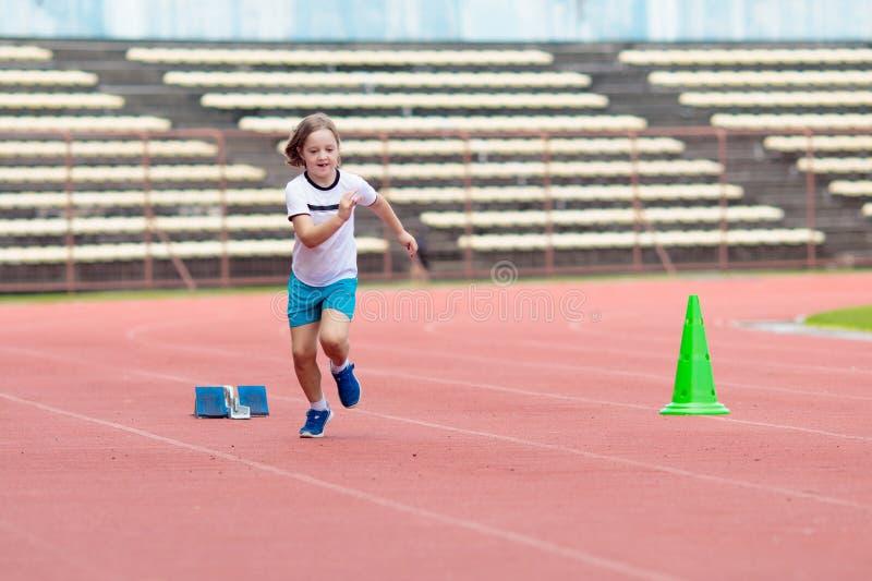 Child running in stadium. Kids run. Healthy sport royalty free stock image