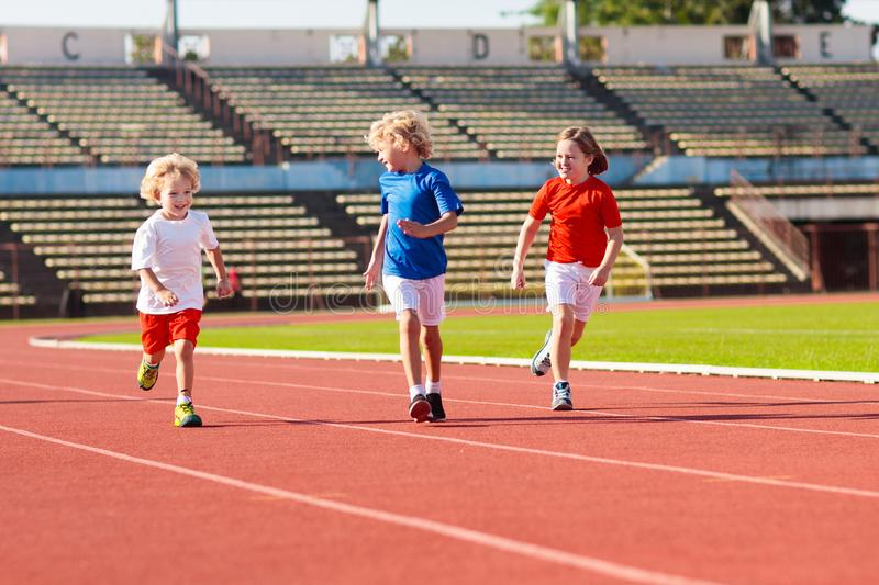 Child running in stadium. Kids run. Healthy sport royalty free stock photography