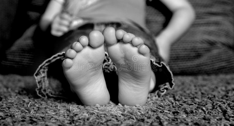 Child's Bare Feet. Young Child's bare feet on floor of home stock photography
