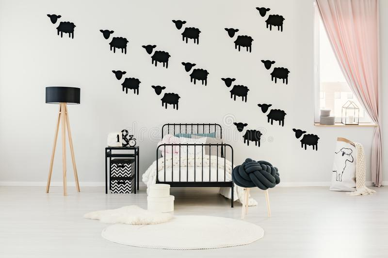 Child`s bedroom with sheep stickers royalty free stock image