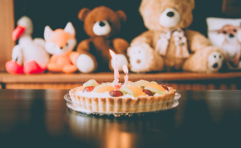 Child`s Birthday cake with candles royalty free stock photo