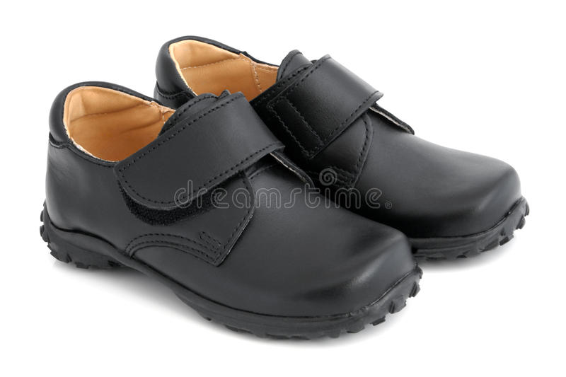 Child's black shoes. On a white background royalty free stock photos