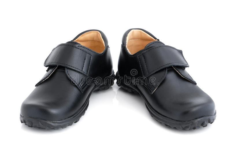 Child's black shoes. On a white background royalty free stock photography