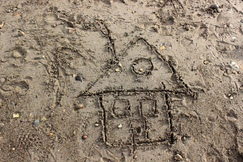 Child's Drawing of a House in Sand royalty free stock images