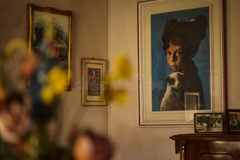 The child`s gaze with the painting dog stock photo