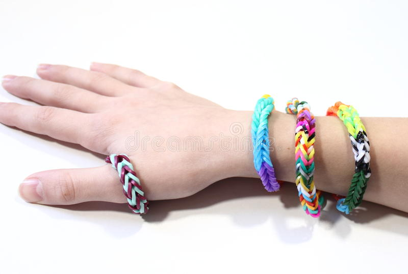 Child's hand with bracelets stock images