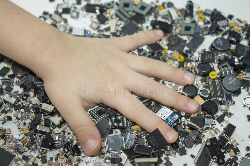 SMT components and a child hand in them. stock images