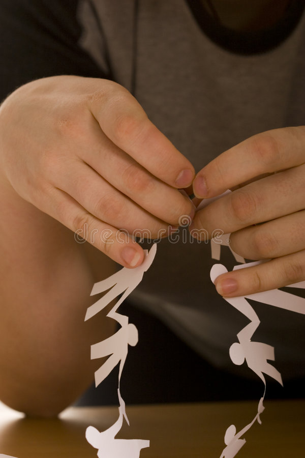 Child`s hand do paper chain royalty free stock photography