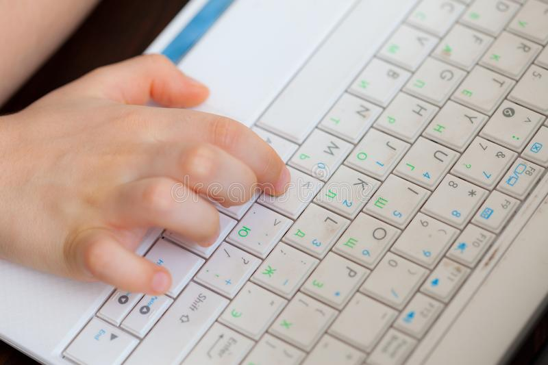 Child`s hand on the laptop keyboard royalty free stock images