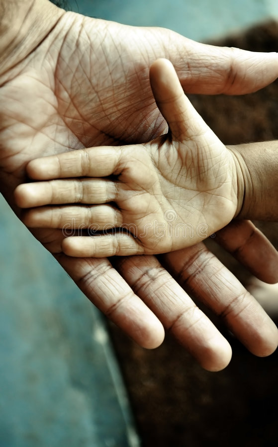 Child S Hand On Top Of An Adult S Stock Photos