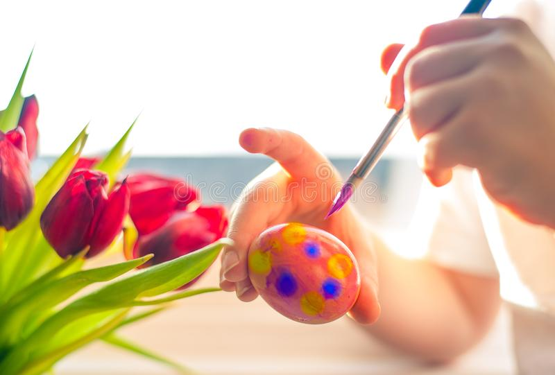 Child`s hands decorating Easter egg. Negative space. royalty free stock photos