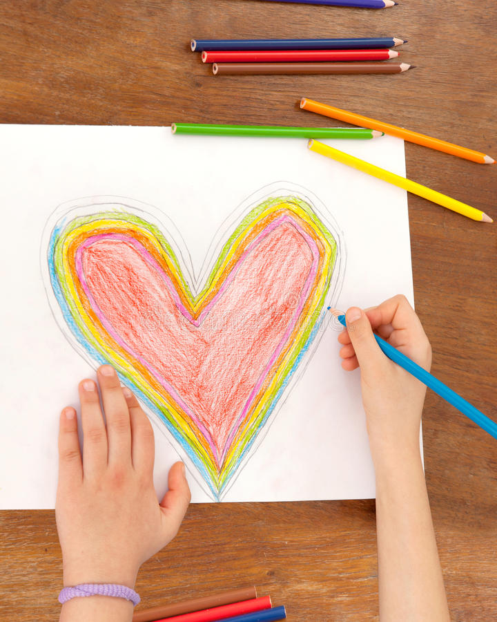 Child's Hands are Drawing a Heart That. Little Girl is Drawing Red Heart. Mothers Day. Fathers Day. Valentines Day. Birthday stock images