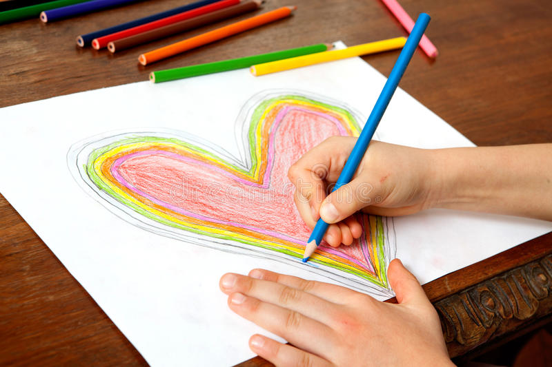 Child's Hands are Drawing a Heart That. Little Girl is Drawing Red Heart. Mothers Day. Fathers Day. Valentines Day. Birthday stock photos