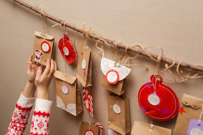 Child`s hands holding a gift from advent calendar.  royalty free stock photos