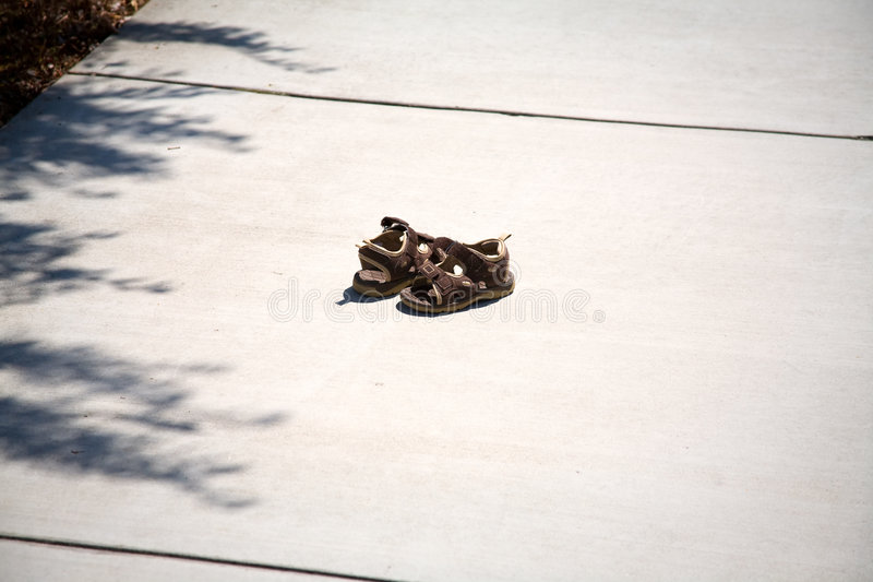 Child's Lost Shoes. A Pair of Child's Shoes Lost on the Sidewalk stock photos