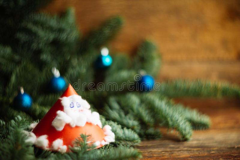 Child's painting of Santa Claus with bag. Christmas background, texture, substrate, layout: children's crafts from paper - Santa Claus with fir branches stock images