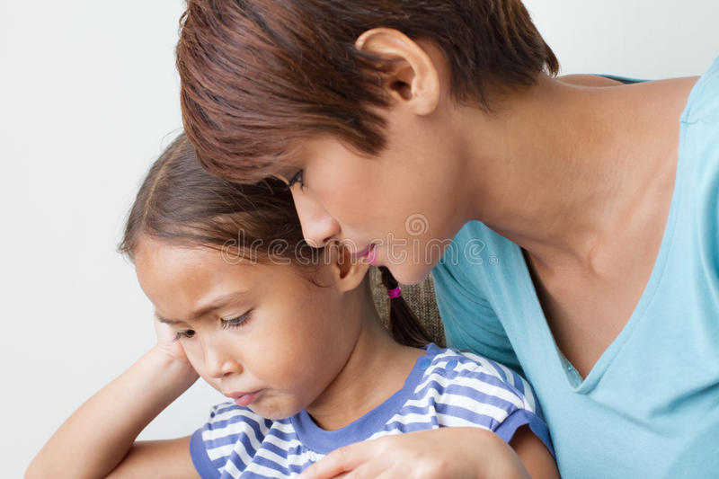 Child's problem with caring mother stock image
