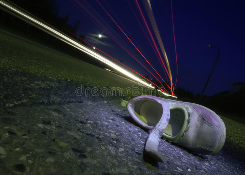 Child's shoe after accident stock photos