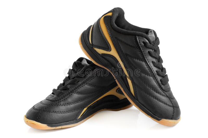 Child's sport shoes. On a white background royalty free stock photography