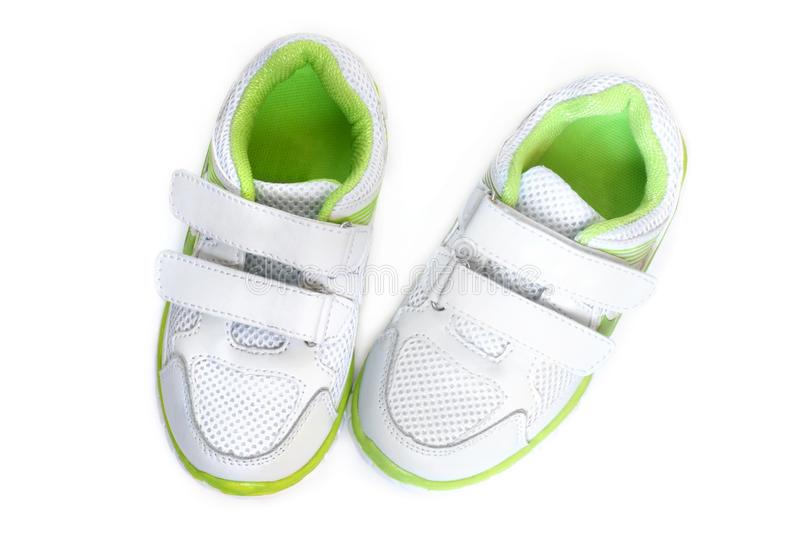 Child's sport shoes. On a white background royalty free stock images