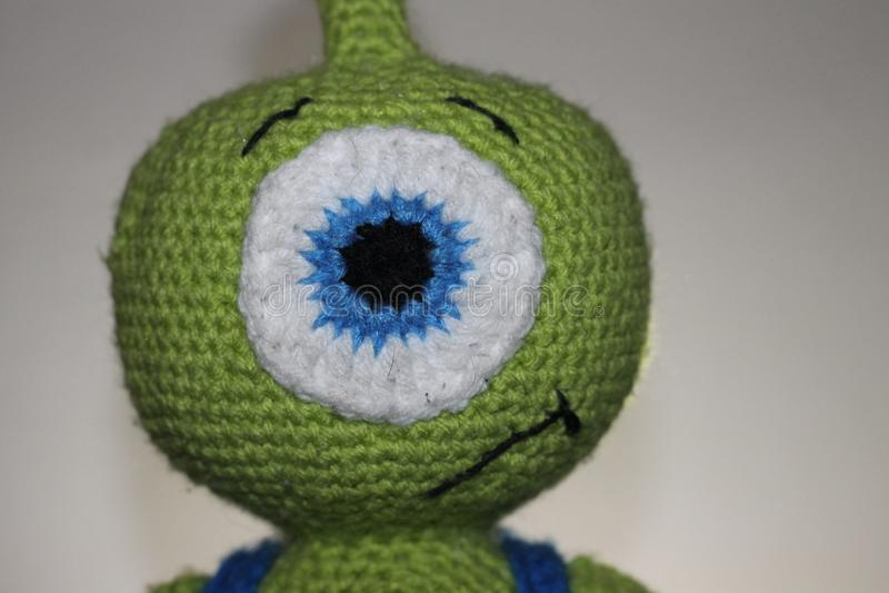 Crotchet alien toy. Child& x27;s stuffed toy stock photos