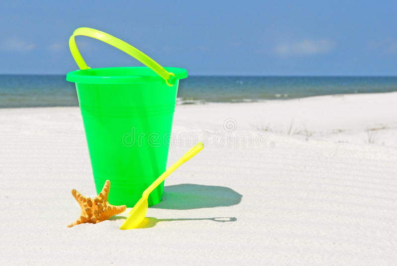 Child's toy on beach stock images
