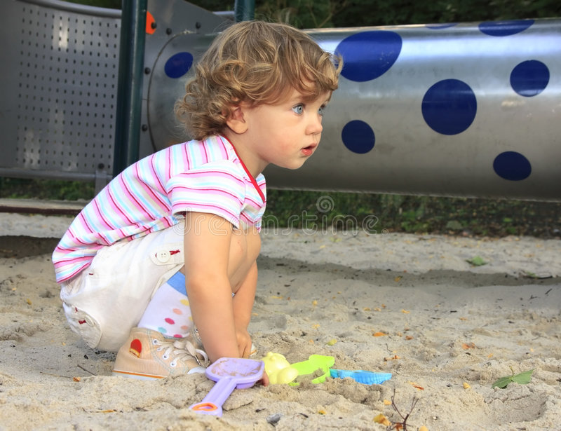 Child in the sandbox stock images