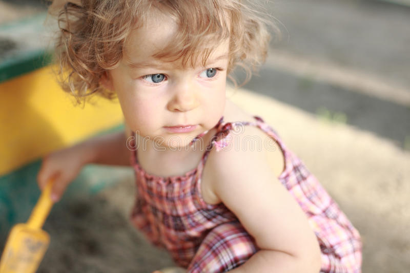 Child in sandpit. Child plays in sandpit - shallow depth of field royalty free stock photos