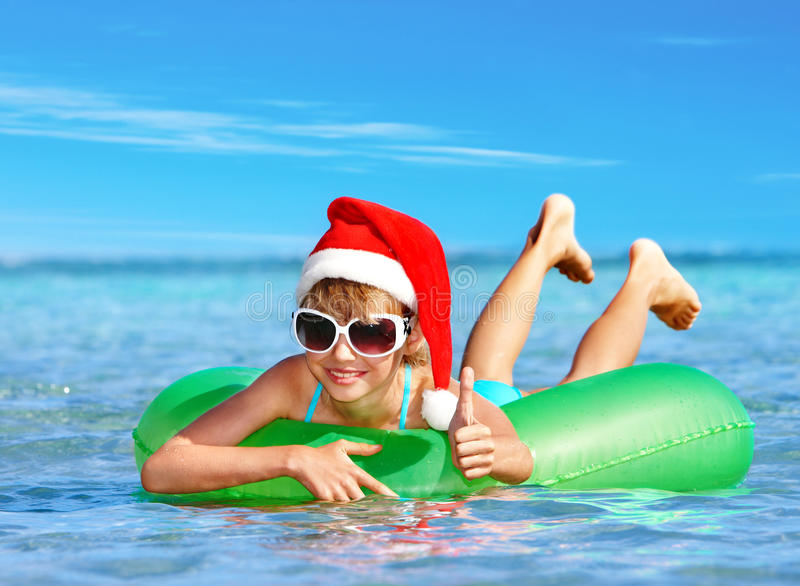 Download Child In Santa Hat  Floating At  Sea. Stock Photo - Image: 27849656