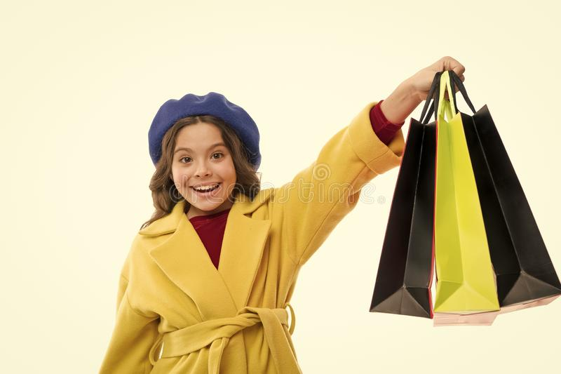 Child satisfied by shopping isolated white background. Obsessed with shopping and clothing malls. Shopaholic concept royalty free stock photos