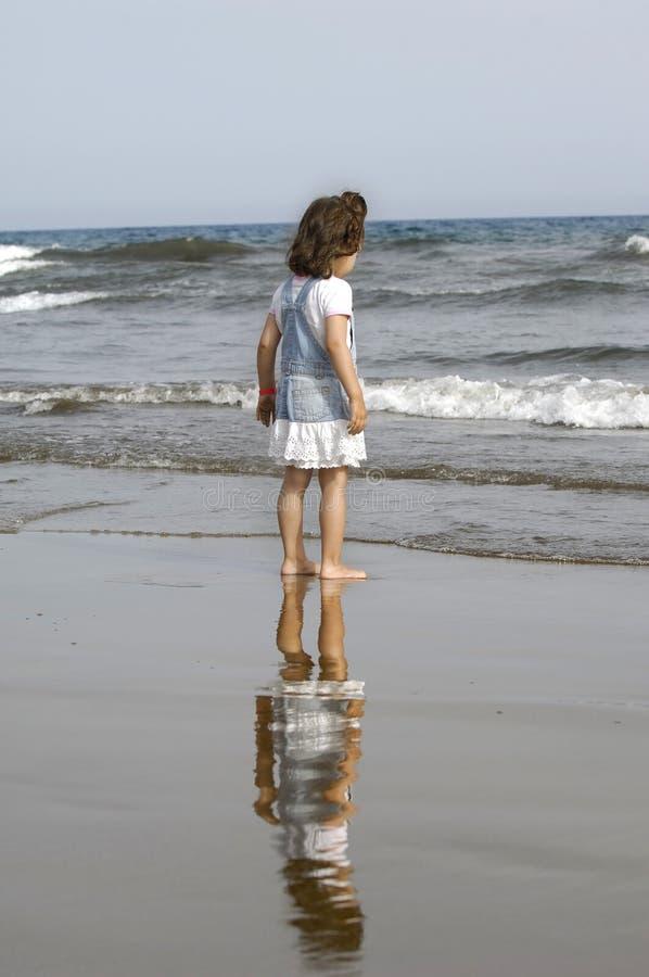 Child and sea stock photo